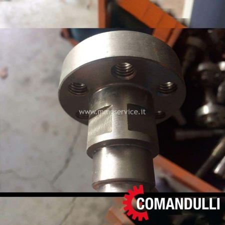 Eccentric and concentric pin to crown movement Comandulli