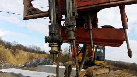 Track loader Komatsu 340 with drilling machine